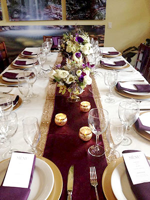 A wedding table replete in purples and golds at the Sunshine Coast Waterfront Vacation Rental. Photo credit: Coco Photography